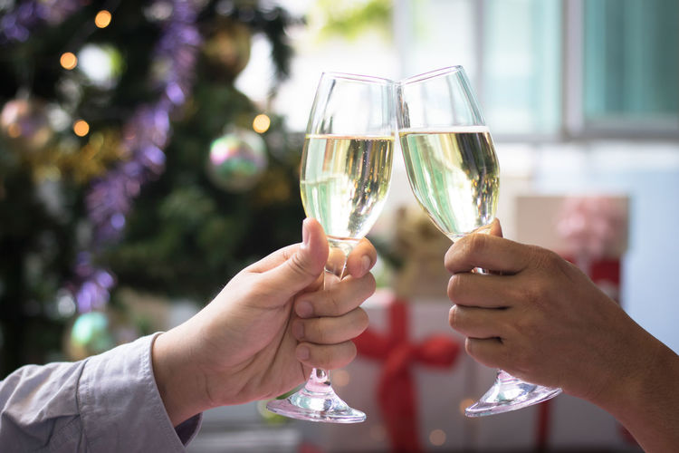 Alcohol Celebration Celebratory Toast Couple - Relationship Drink Event Focus On Foreground Food And Drink Glass Hand Holding Human Body Part Human Hand Men Positive Emotion Real People Refreshment Togetherness Two People Wine Wineglass Women
