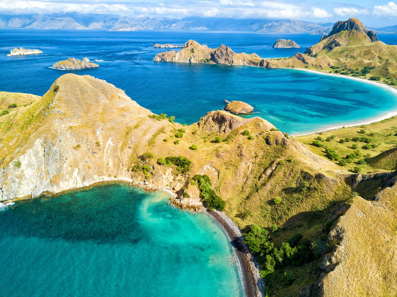Aerial view of two beautiful beaches on Pulau Padar island in between Komodo and Rinca Islands near Labuan Bajo in Indonesia. DJI X Eyeem DJI Mavic Pro Dragon Flores Island INDONESIA National Park Tourist Travel Travel Photography Aerial Aerial Photography Aerial View Destination Dji East Nusa Tenggara Flores Komodo Labuan Bajo Landscape Padar Pulau Rinca Tourism Tropical Vacation