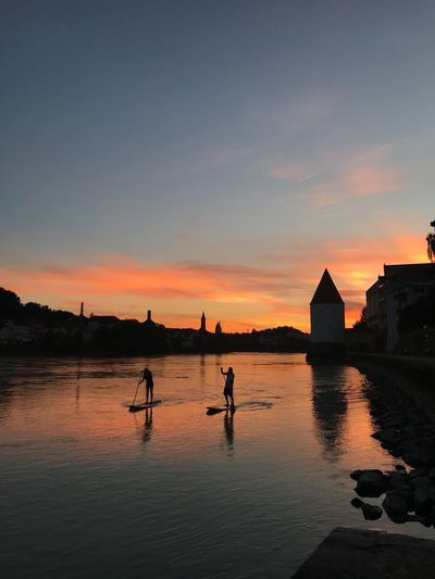 Passau Germany Passau Water Sky Sunset Reflection Real People Architecture Built Structure Cloud - Sky Scenics - Nature Silhouette Beach Building Exterior Men Land Orange Color Beauty In Nature Nature Lifestyles Transportation Outdoors
