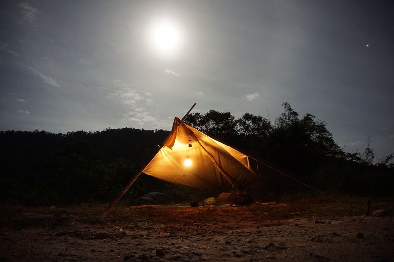 Open tent under the full moon Tree Sky Nature Night Plant Illuminated Land Shape Tent Glowing Cloud - Sky No People Dusk Field Outdoors Lighting Equipment Back Lit Non-urban Scene Forest Scenics - Nature