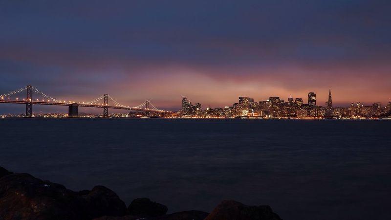 San Francisco Bay Bridge San Francisco Skyline Treasure Island Sunset Transamerica Night Shots  Landscapes With WhiteWall Battle Of The Cities