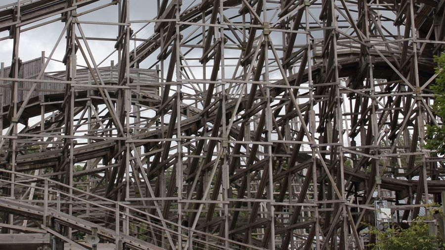 Close-Up Of Wood Frames Along Rollercoaster Tracks