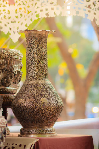 Beautiful Ancient Thai genuine silver jar, retro engraved silverware, Beautiful genuine silver jar handicrafts of Thailand Souvenir Shop Close-up Day Focus On Foreground Indoors  Jar No People Silver Jar Silver Jewelery Silver Jewellery Silver Jewelry Silver Jug Souvenir Table Vase