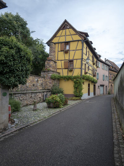 Street of Turckheim, Alsace Architecture Built Structure Building Exterior Tree Plant Sky Building Road Transportation House Nature City Residential District Direction No People Street The Way Forward Day Cloud - Sky Outdoors Wine City Turckheim Greipa Alsace