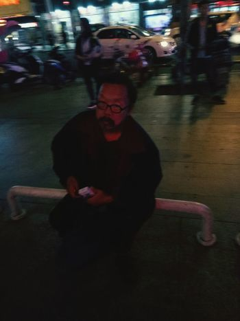Only Men One Man Only One Person Mature Adult Adults Only Adult One Mature Man Only Red People Eyeglasses  Night Evil Mature Men Sitting Spooky Looking At Camera Men Lifestyles Full Length Indoors  Oldman Homeless