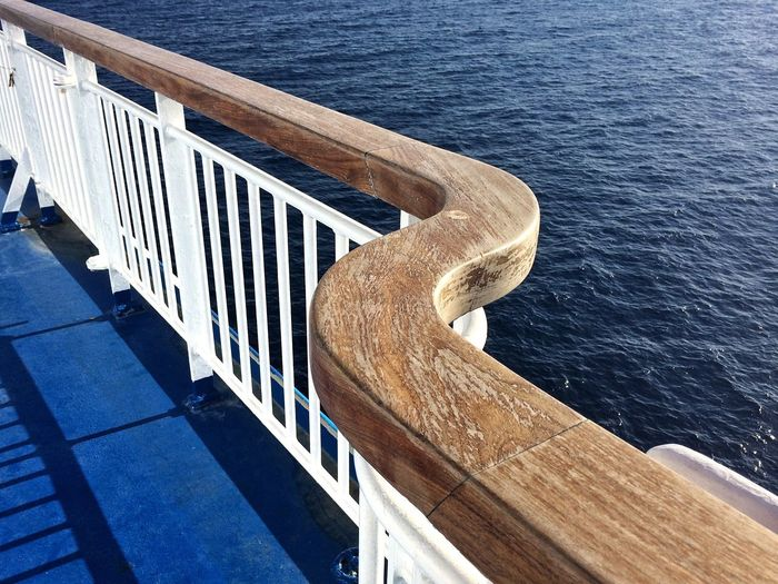 High angle view of railing by sea