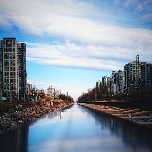 City Architecture Built Structure Cityscape Cloud - Sky Outdoors Urban Skyline Sky Day Modern Freshness Tranquil Scene Diminishing Perspective The Way Forward Huawei P9 Photos Street Photography Beijing, China Cityscape Mirrored Reflection Railroad Track Reflection Straight Silhouette Light And Shadow Shadows & Lights