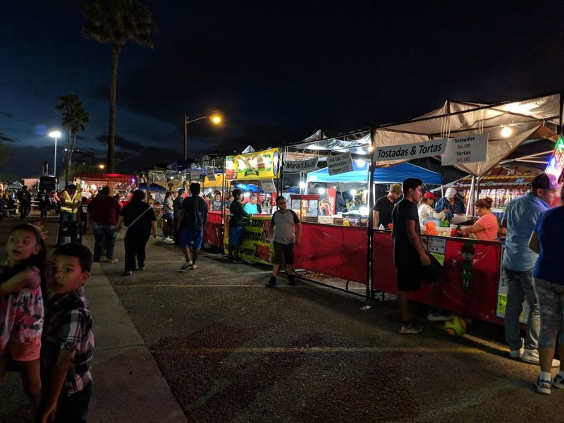 Street market at the McAllen Candle Light Posada festival. Crowd Festival Illuminated Large Group Of People Market Market Stall Mcallen Night Outdoors Parade Retail