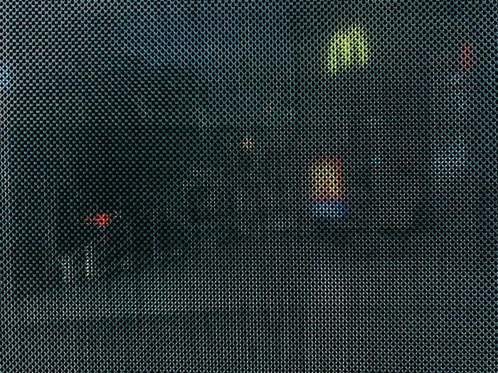 Full frame shot of illuminated car against sky at night