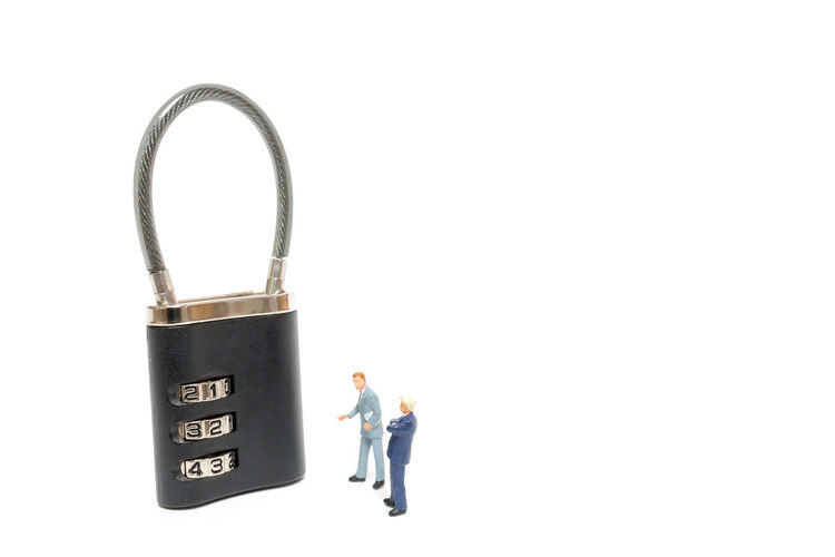 Miniature people : businessman helps to unlock password on the keys : Business concept the solution to the problem. Business Businessman Concept Design Door Figure Group Key Lock Man Metal Miniature Object Open People person Property Real Safety Security Success Symbol Team Teamwork Toy Unlock Work
