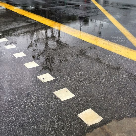 Wet road marking on street