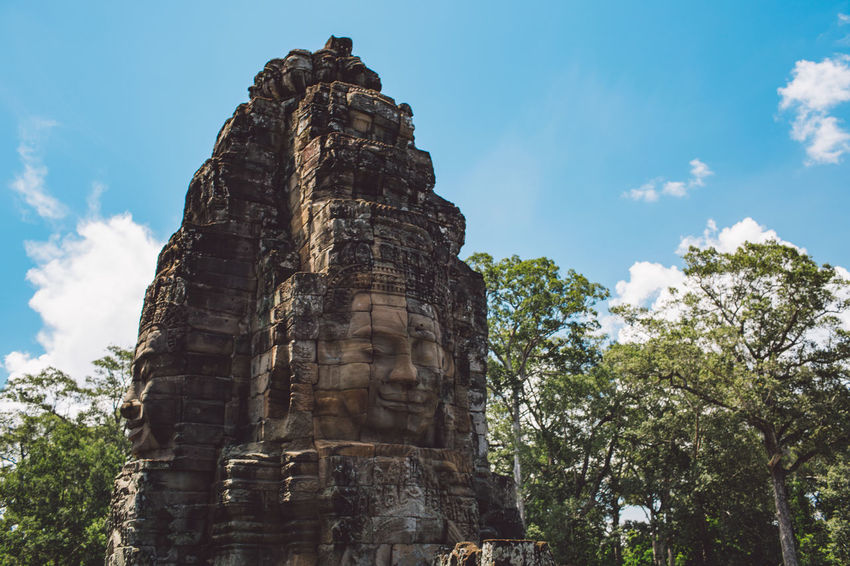 Siem Reap Cambodia Angkor Low Angle View Architecture Built Structure Place Of Worship Sky Travel Destinations Travel Religion History Belief Ancient The Past Spirituality Tourism Tree Nature Day No People Art And Craft Outdoors Ancient Civilization