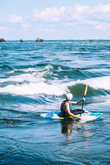Lost In The Landscape Adventure Beauty In Nature Day Extreme Sports Horizon Over Water Jet Boat Leisure Activity Lifestyles Men Motion Nature Nautical Vessel Oar One Person Outdoors People Real People Scenics Sea Sky Sport Water Waterfront Wave