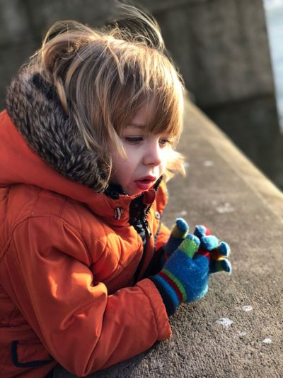 EyeEm Selects Childhood One Person Warm Clothing Cute Real People Outdoors Day Bubble Wand Blond Hair Playing Close-up People Child