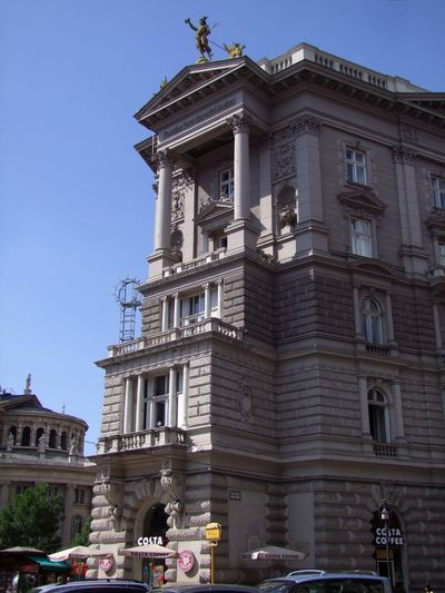 Bank Building, Andrassy Street Andrássy Street Architectural Columns Architectural Features Architecture Bank Building Blue Sky Budapest Building Building Exterior Built Structure Capital City Composition Hungary Low Angle View No People Outdoor Photography Statue Sunlight And Shade Travel Destination