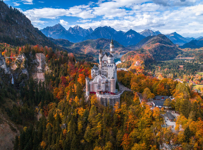 Such a magical Autumn Valley. Autumn Bavaria Castle Cityscape Deutschland Fairy Tale Neuschwanstein Autumn Beauty In Nature Cloud - Sky Clouds Europe Forest Germany Landmark Landscape Mountain Mountain Range Nature Scenics Sky Tranquility Travel Destinations Tree Valley