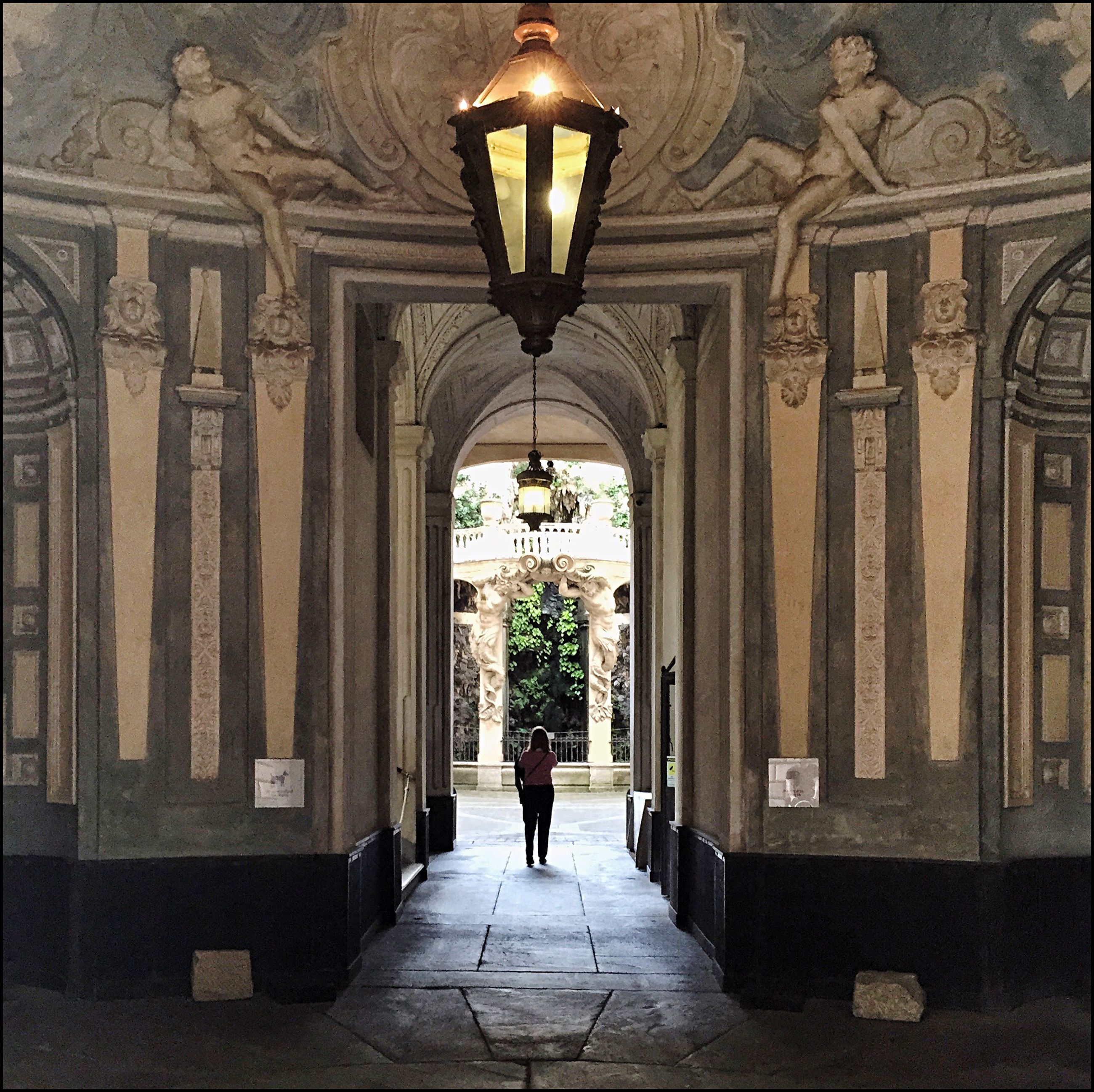 architecture, indoors, built structure, the way forward, men, rear view, walking, arch, corridor, person, full length, lifestyles, entrance, architectural column, diminishing perspective, tiled floor, leisure activity, lighting equipment
