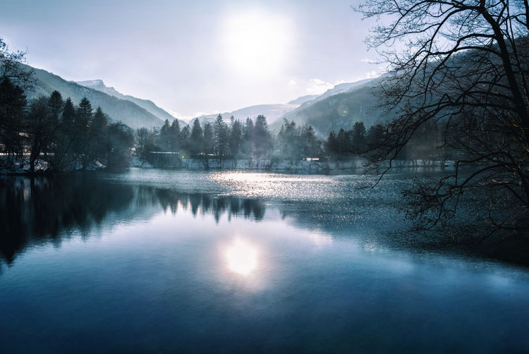 Blue lake with fog and water reflection