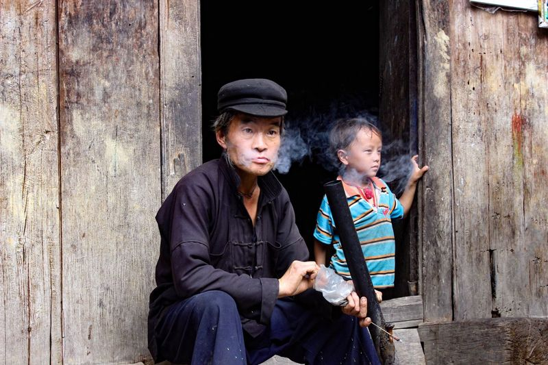Granpa & grandson in North West of Vietnam Child Boys Togetherness People Males  Friendship Childhood Adult Sitting Men Day Grandpa Grandfather Lifestyles Cultures Family Oldpeople Homelans
