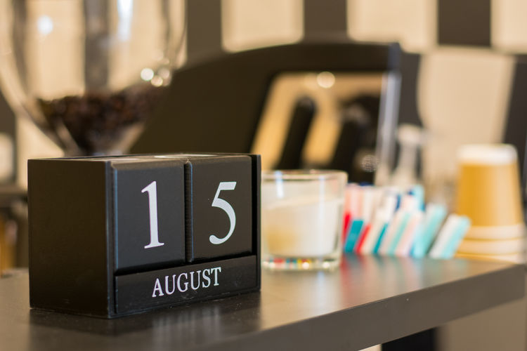 Close-up of calendar date on table