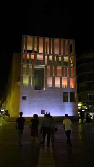 ezefer Architecture Building Built Structure Cities At Night Cities At Night Eyeem Awards 2016 City City Life City Street Group Of People Illuminated Leisure Activity Lifestyles Modern Multi Colored Night Outdoors