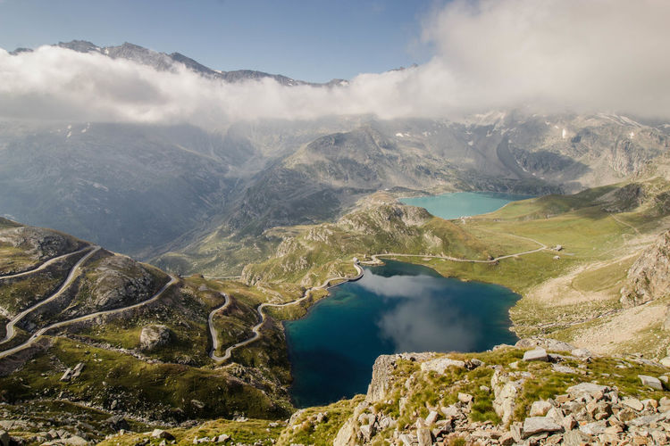 Scenic view of lake and mountains in italian alps