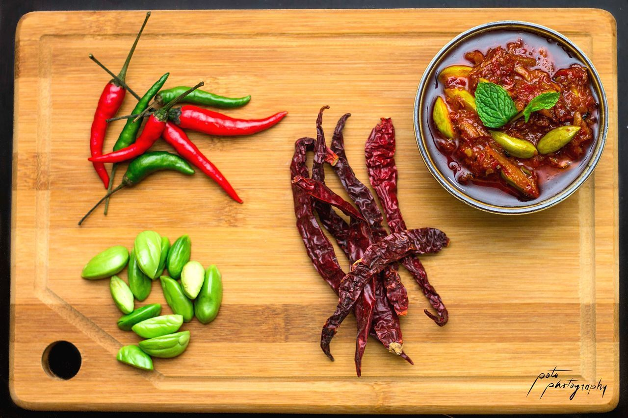 food and drink, food, vegetable, pepper, chili pepper, freshness, spice, cutting board, healthy eating, red chili pepper, directly above, meat, red, indoors, high angle view, ingredient, wellbeing, table, wood - material, no people
