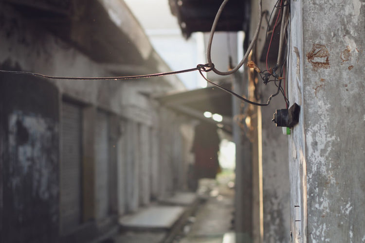Close-up of cable hanging on wall