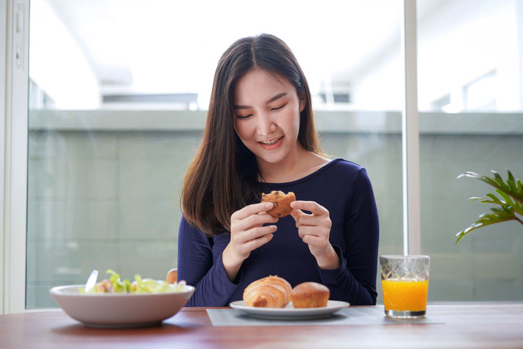 Young woman having food