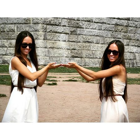 Twins Pretending to Hold something Up , can you guess what? girls shades dress brunette summer trip travelling Made with @nocrop_rc rcnocrop