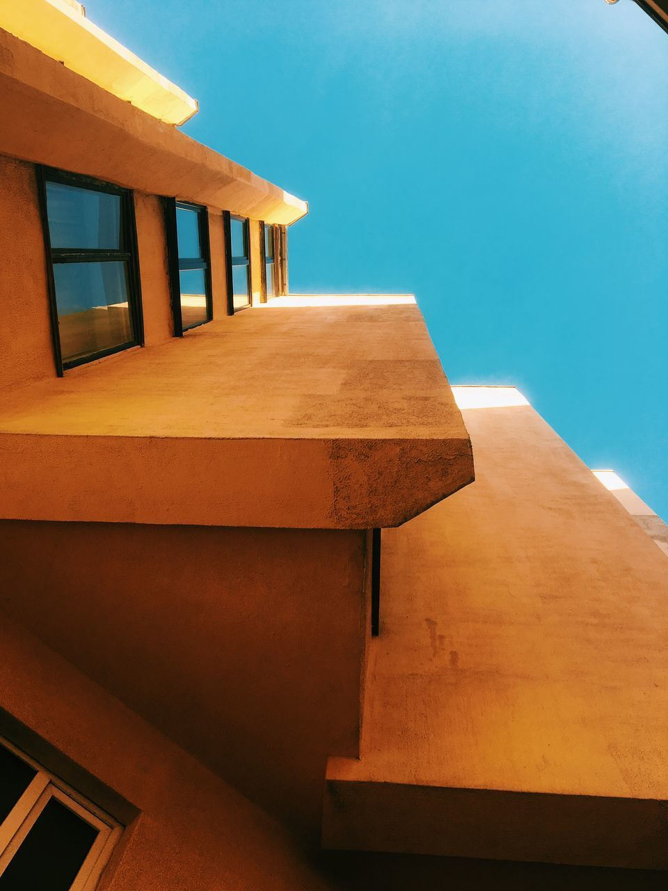 architecture, built structure, no people, sky, clear sky, nature, day, sunlight, building exterior, blue, building, outdoors, low angle view, wood - material, roof, close-up, staircase, copy space, water, pattern