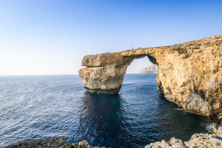 Rock Formation At Gozo Island Against Clear Sky