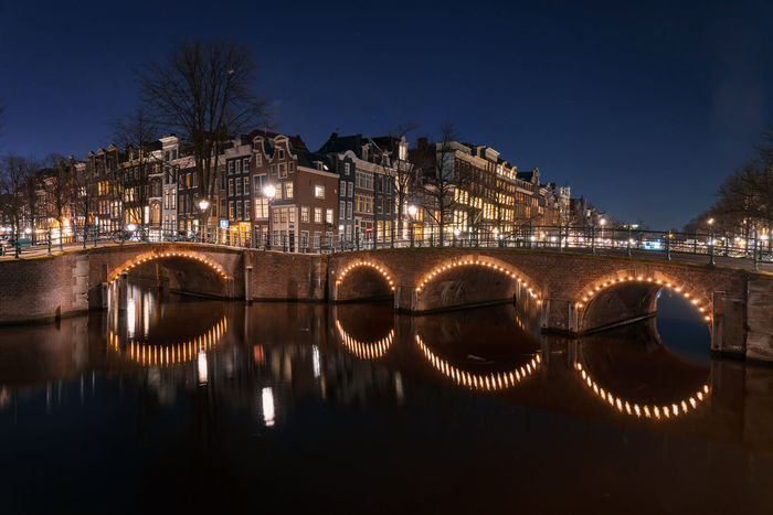Amsterdam canal at night Amsterdam Dutch Cities Netherlands Prinsengracht Reflection UNESCO World Heritage Site Architecture Building Exterior Built Structure Canal Canals And Waterways City Dutch Herengracht Holland Illuminated Jordaan Night No People Outdoors Prinsenstraat Water
