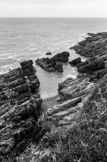please feel free to see more at vsco.co/idimarco Beauty In Nature Blackandwhite Cliff Day Film Photography Horizon Over Water Langland Bay Nature No People Non-urban Scene Outdoors Remote Rock Rock - Object Scenics Sea Seascape Shore Sky Tourism Tranquil Scene Tranquility Wales Water