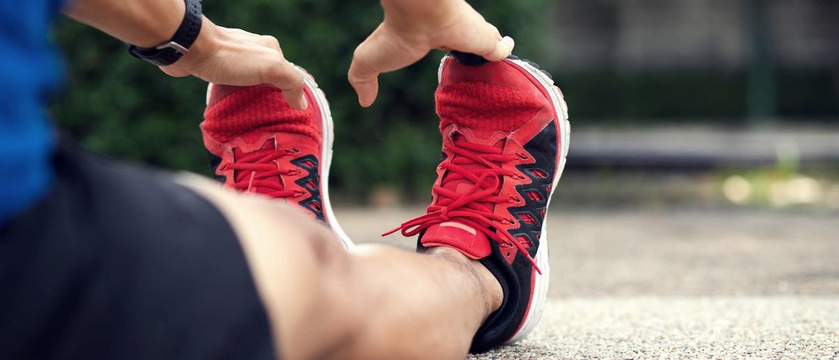 Sporty man stretching exercise for warming up before running in the park.healthy lifestyle concept.