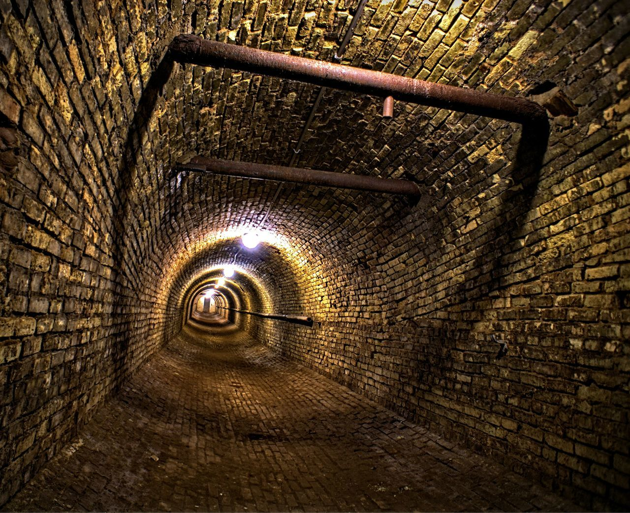 Narrow Pathway In Tunnel Along Walls