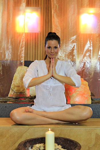 Portrait Of Young Woman Meditating In Spa