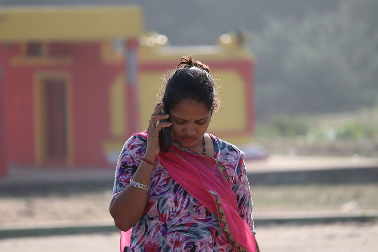 Close up shot of stylish young woman to chatting her cell phone , indian woman