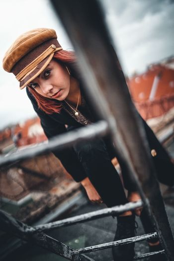 One Person Young Adult Real People Clothing Young Women Selective Focus Lifestyles Day Looking Adult Metal Leisure Activity Fashion Women Hat Mid Adult Holding Side View Outdoors Beautiful Woman
