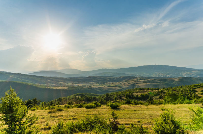 Scene with sun sky and clouds overlooking the green valley near Skopje Macedonia Sun Star Sunlight Beauty In Nature Day Fields Landscape Mountain Mountain Range Nature No People Outdoors Scenics Sky Sun Sun Light Sunlight Sunset Sunshine Tranquil Scene Tree Valley