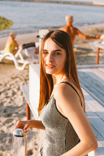 Portrait of beautiful young woman on beach