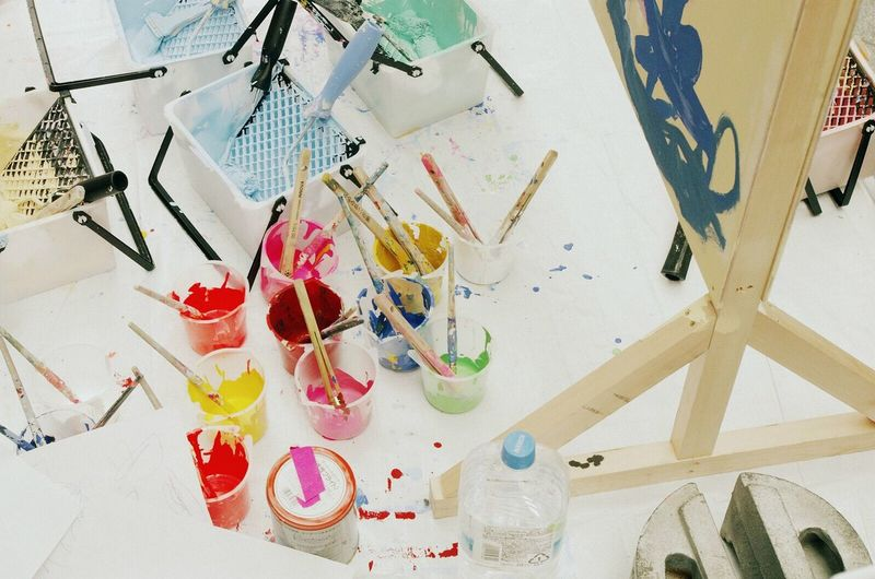 High angle view of watercolor paints on table