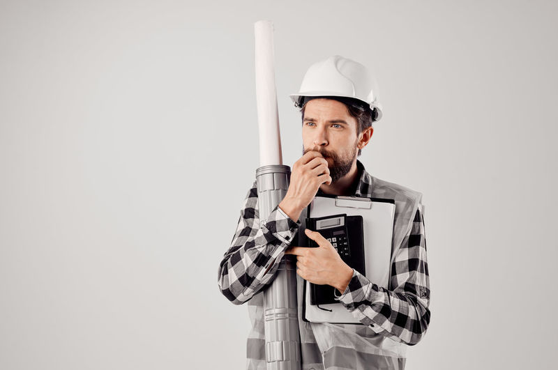 Man working against white background