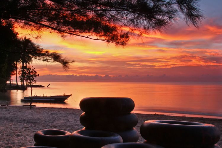 Beautiful sunrise in Manggar beach, Balikpapan INDONESIA Balikpapan Beach Beauty In Nature Cloud - Sky Horizon Horizon Over Water Idyllic Land Manggar Nature No People Orange Color Outdoors Plant Scenics - Nature Sea Sky Sunrise Sunset Tranquil Scene Tranquility Tree Water