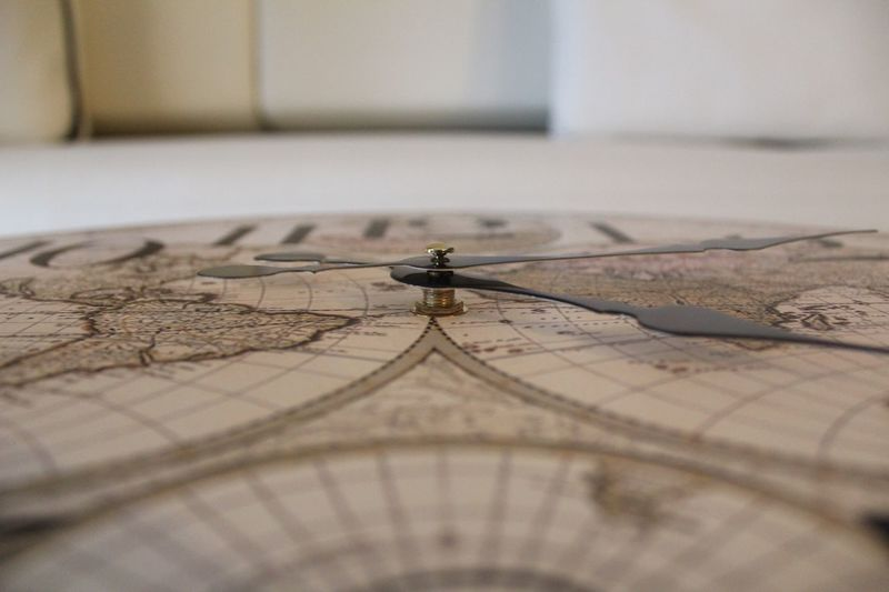 Close-up of world map clock