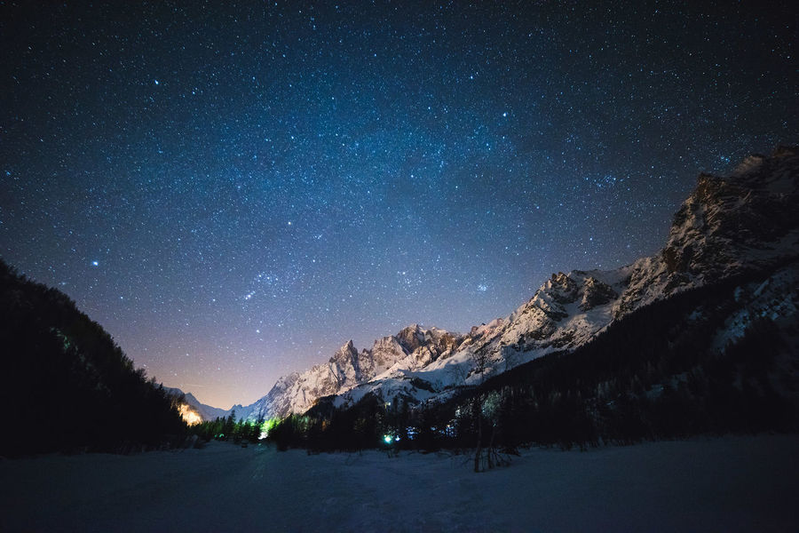 Astronomy Beauty In Nature Galaxy Idyllic Milky Way Mountain Nature Night No People Non-urban Scene Scenics - Nature Sky Snow Snowcapped Mountain Space Star Star - Space Star Field Tranquil Scene Tranquility Tree Winter