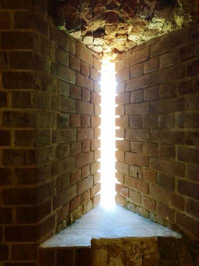 Sunlight falling on illuminated wall