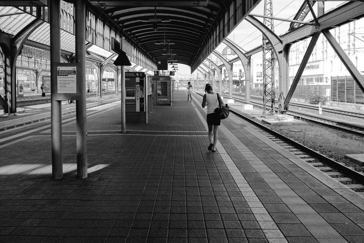 Modern Girl Alone... Apparel City Life Clothes Composition Confident  Danger Emancipatrion Empty Girl Harassment Miniskirt Perspective Public Transportation Rail Transportation Railroad Station Railroad Station Platform Railroad Track Shirt Skirt Summer Tourist Transportation Walking Woman