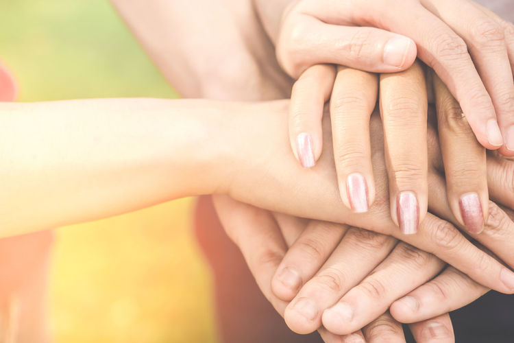 three hand holding together ,unity,business teamwork,friendship,partnership concept background Friends Happy Love Pray Relationship SUPPORT Teamwork Unity Adult Agreement Body Part Deal Finger Friendship Hand Holding Human Body Part Human Finger Human Hand Partnership - Teamwork People Success Three Togetherness Women