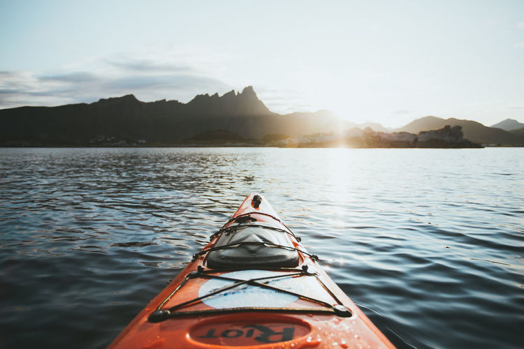 Kayak in lake against sky